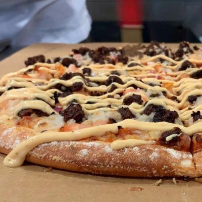 Photo of vegan beef on a Domino's pizza.