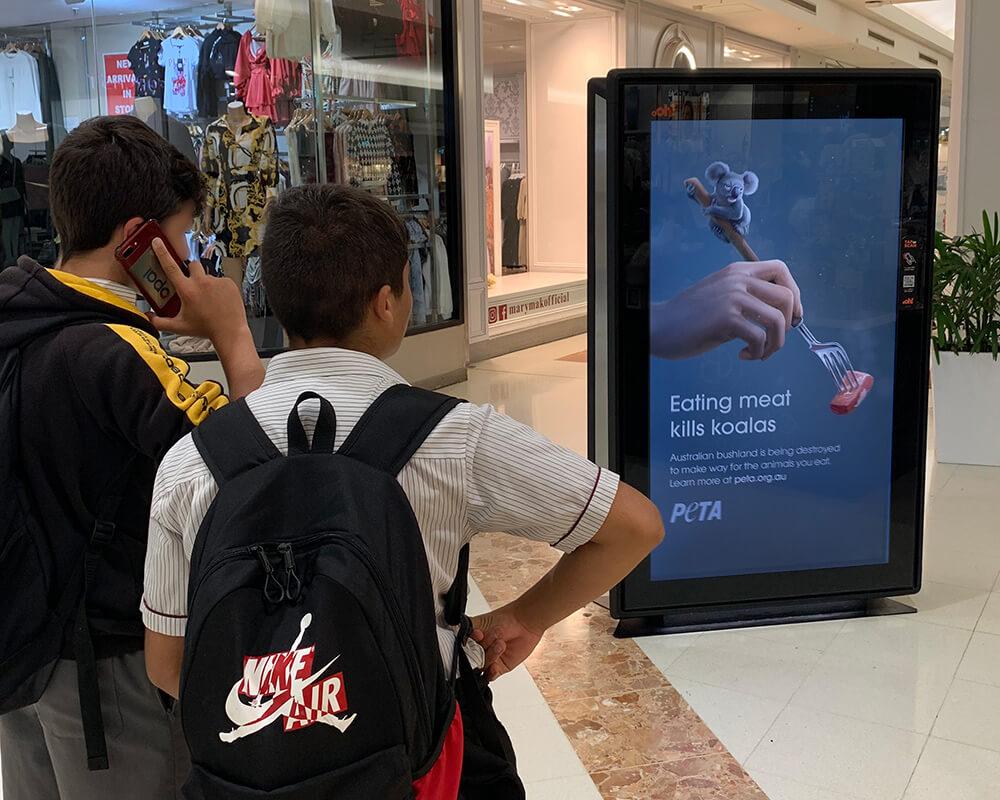 "PETA's billboard ad which says ""eating meat kills koalas"""