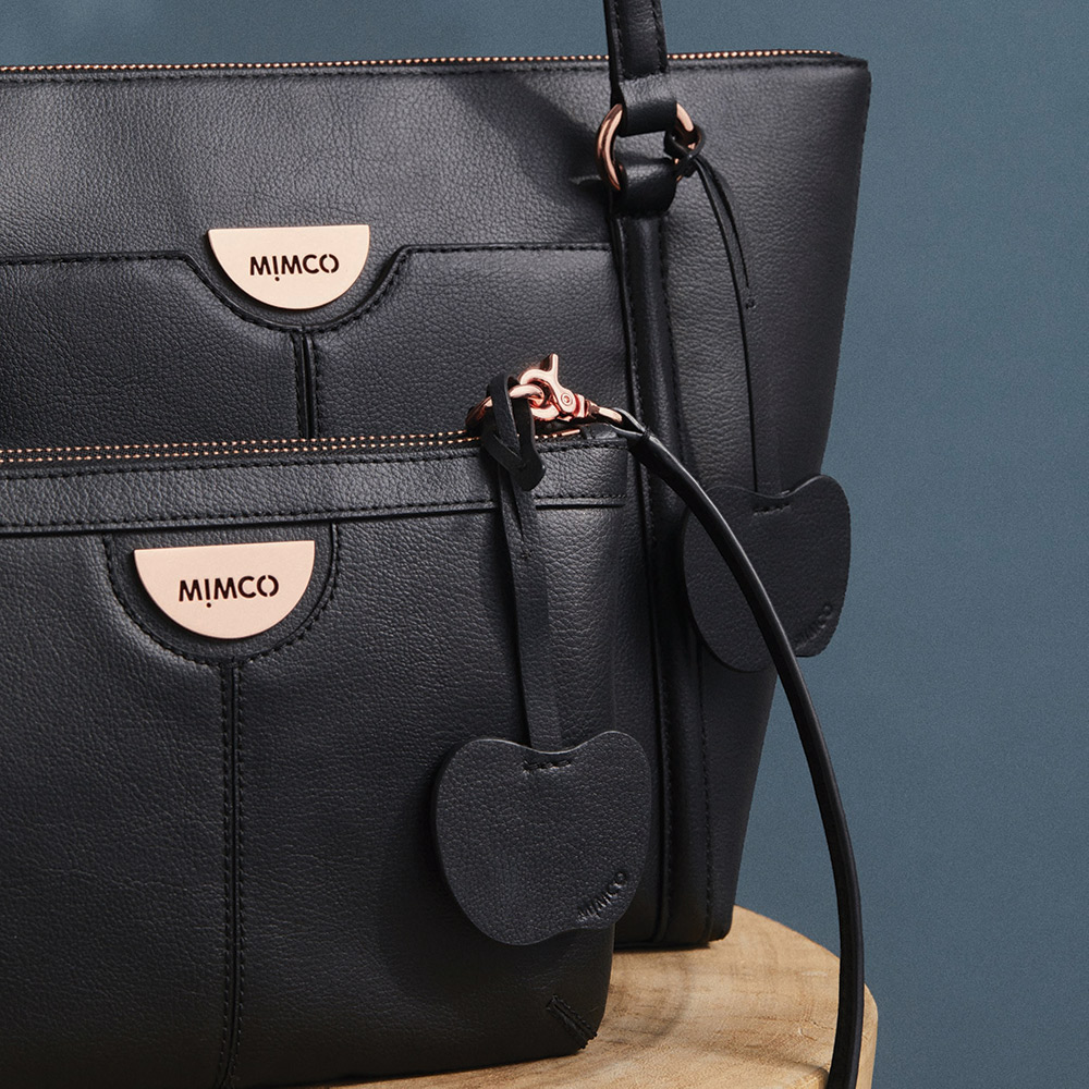 A photo of MIMCO's apple peel leather bags.