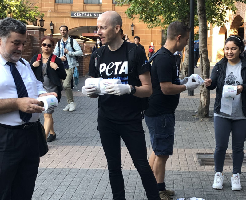 A photo of PETA supporters handing out toilet paper.