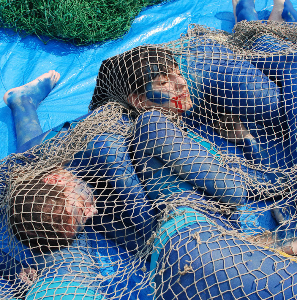 Protesters caught in nets.