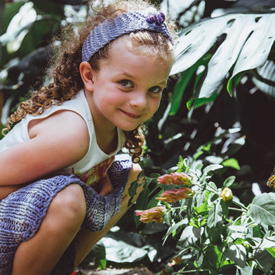A child with a butterfly in the botanic gardens