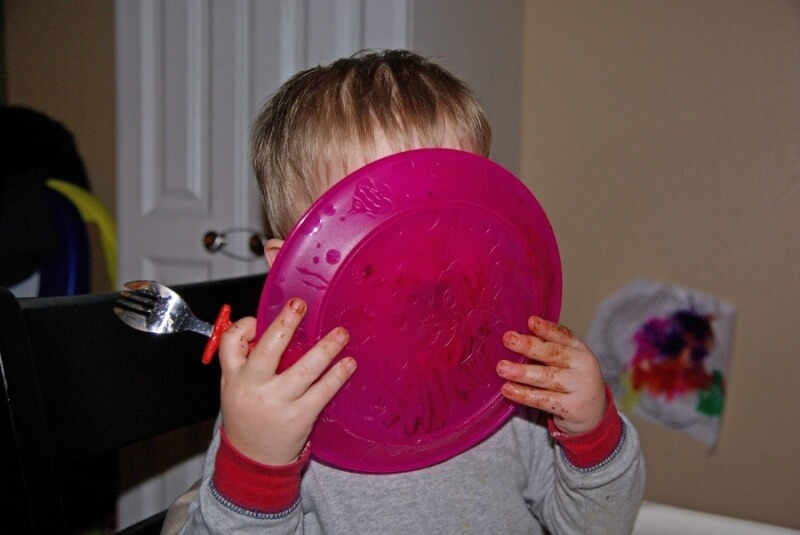 child licking plate