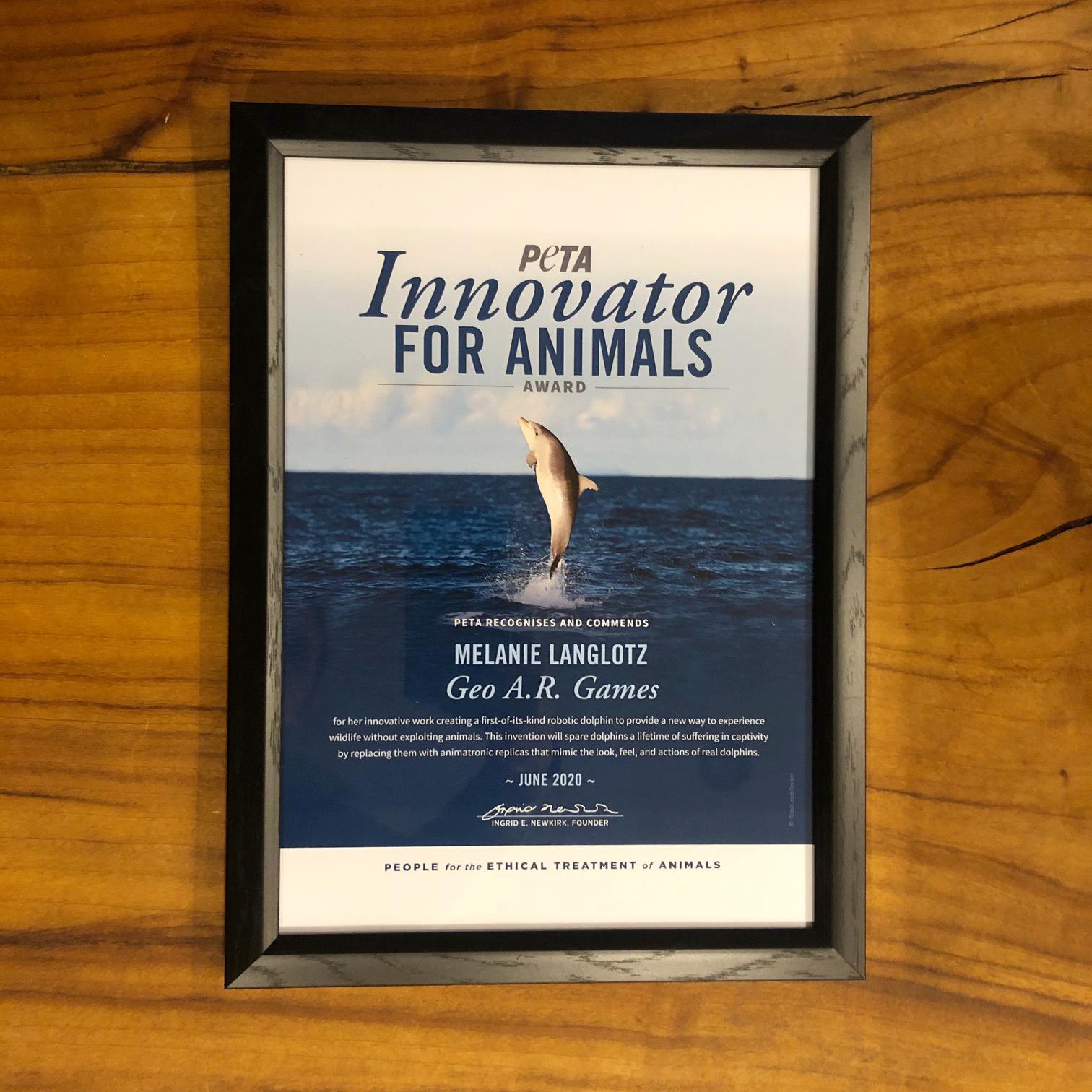 A framed Innovator For Animals Award.