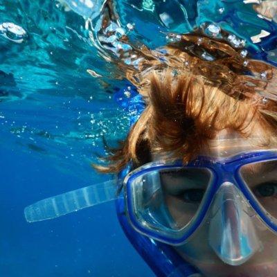 A child snorkelling