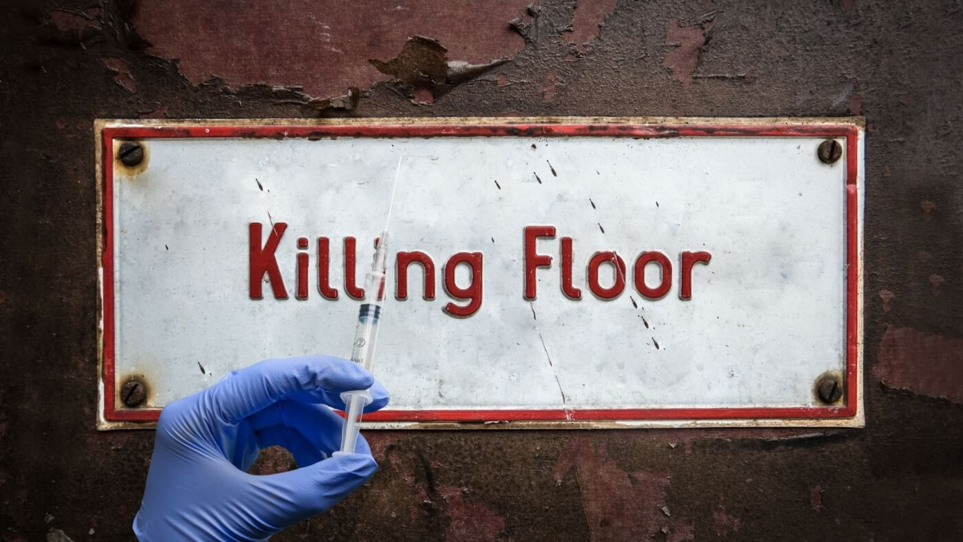 """a sign which says """"killing floor"""" with a vaccination in the foreground"""